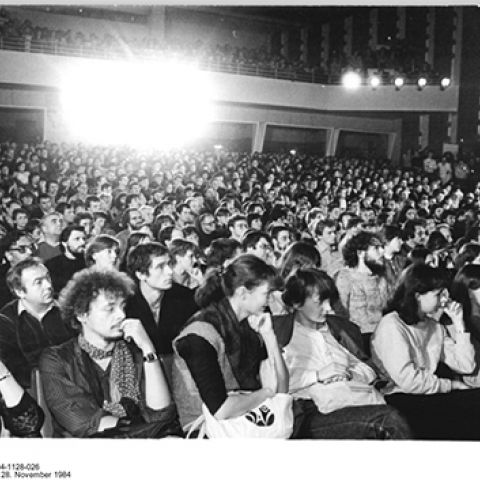 Audience in a fully packed cinema in the 1980s.
